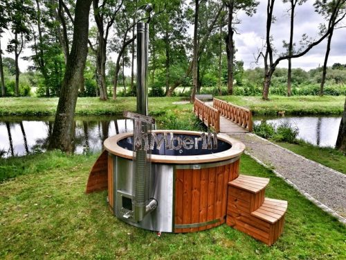 Wood fired hot tub with integrated heater and fiberglass liner